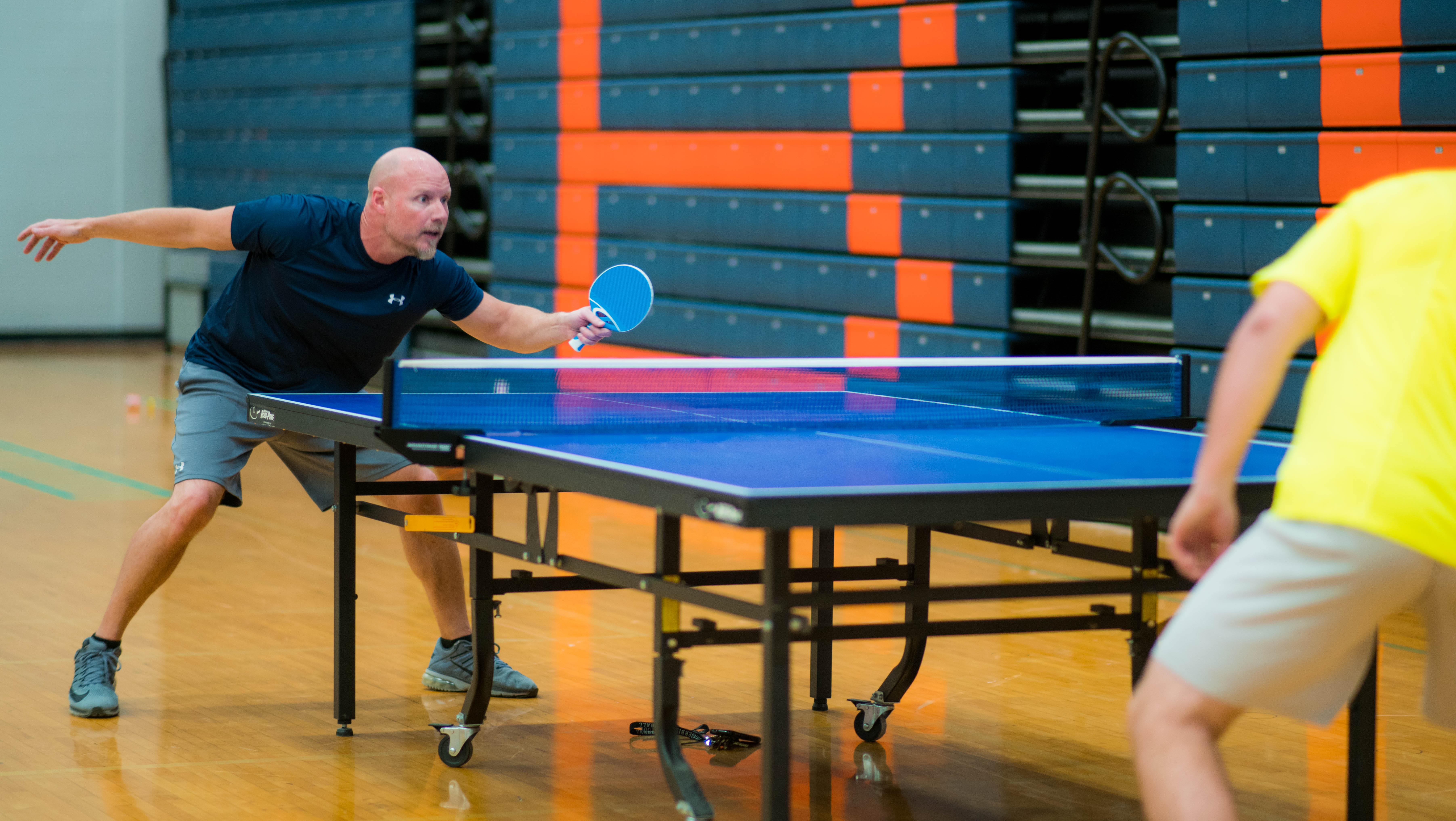 Coach Curry playing Ping Pong
